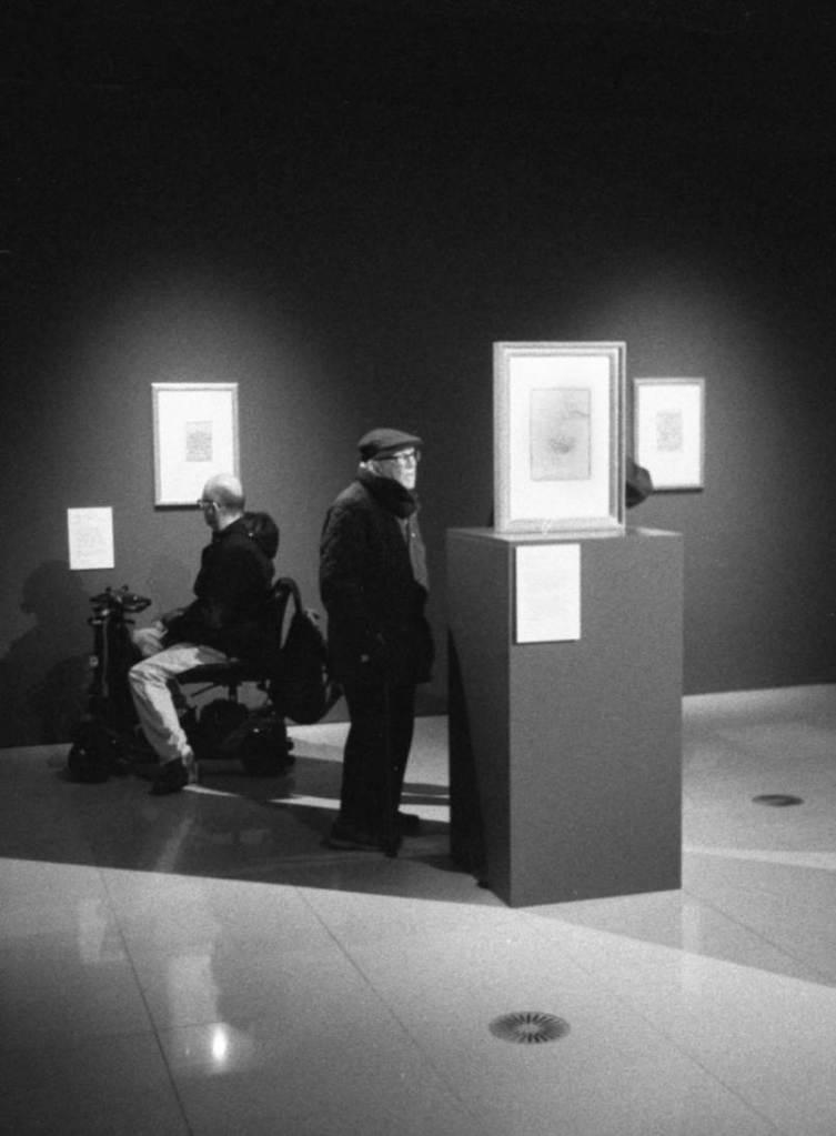 Two Men admire Leonardo DaVinci artwork at Millennium Gallery Sheffield exhibition