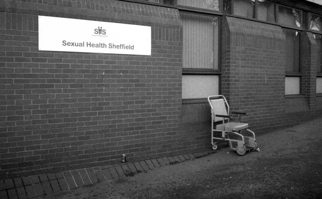 Wheelchair and tin cans left outside sexual health Sheffield