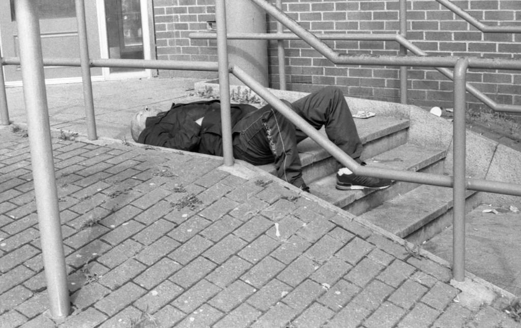 Man sleeps on steps in Sheffield city centre