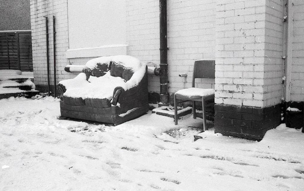 Abandoned furniture sits outside covered in snow off London Road Sheffield